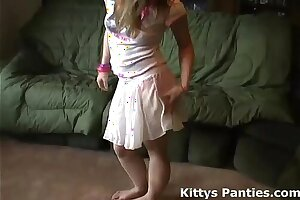 Small teen Kitty showing her underpants in a lil' micro-skirt